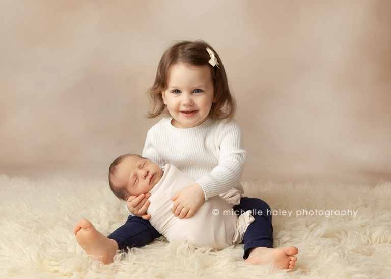 newborn sibling photography